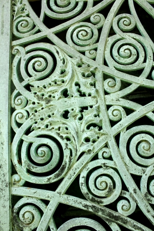 Close up of a panel on metal doors aged and weathered to a green patina, on a mausoleum at Graceland Cemetery, Chicago, Illinois, USA