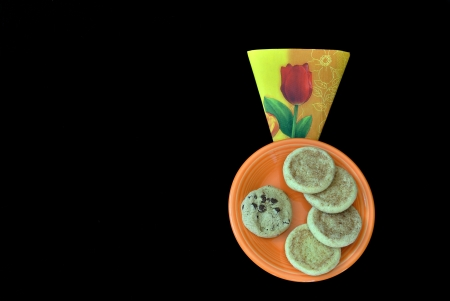 cookies on plate, off-set to allow for copy on Black Backgrd Stock Photo