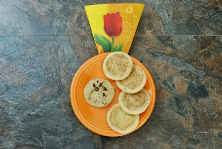 cookies on plate, on slate background photo