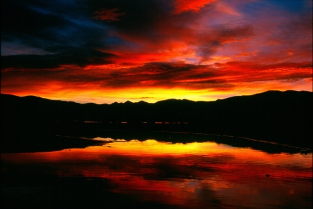 lake dillon: beautiful colorful sunrise at Lake Dillon Colorado with mountains and cloud reflections