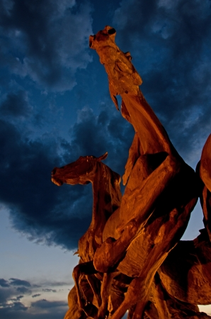 treacherous: Smoke and clouds from the treacherous Waldo Canyon fire create a dramatic backdrop to the Briagate Stallions Statue in Northern Colorado Springs, directly across from the Air Force Academy