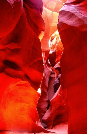 yellows: Reflected light creates spectaculr yellows, reds, oranges and purples on the sandstone walls of Lower Antelope Canyon near Page, Arizona  Stock Photo
