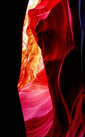 compostion: Reflected light off of sandstone walls create  spectacular colors in Lower Antelope Canyon near Page, Arizona.