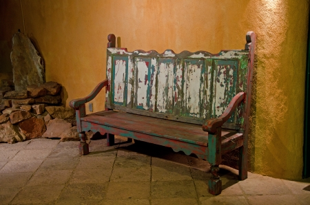 adds: An old bench with faded paint of many colors adds charm to downtown Santa Fe, New Mexico  Stock Photo