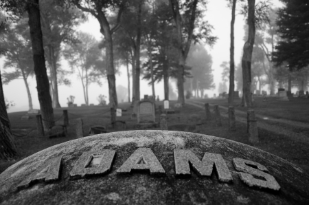 adds: A foggy morning in black and white adds drama and mystery to the Gunnison Cemetary, Colorado. Editorial