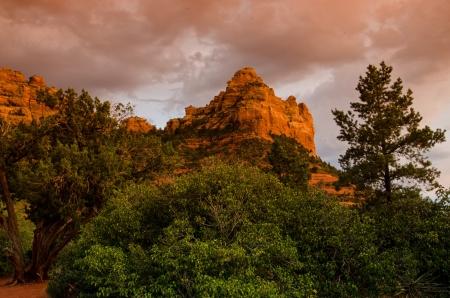 alpenglow: A beautiful pink sunset occurs after a light rain over the red rocks near Sedona, Arizona