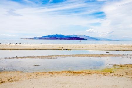 Clouds, mountains, and shoreline of the Great Salt Lake on Antelope Island State Park near Salt Lake City, Utah.