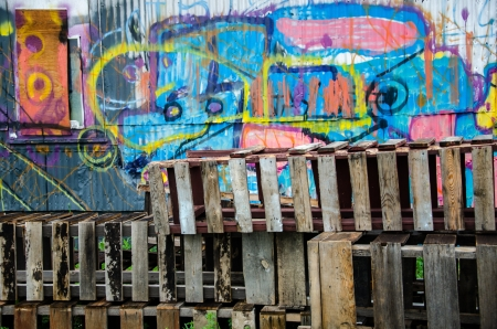 compostion: Vibrant paint, grafitti, and old wooden crates at old warehouse in downtown Colorado Springs Colorado with overcast light