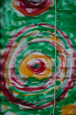 compostion: A colorful pattern of concentric images painted on the outside wall of an old warehouse in downtown Colorado Springs, Colorado