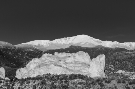 A dramatic blackand white image of the famous Kissing Camels, Garden of the Gods, and snow-capped Pikes Peak after a May snowstorm in Colorado Springs, Colorado