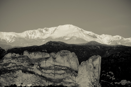 A dramatic black-and-white image of the iconic Kissing Camels monolith in Garden of the Gods and snow-capped Pikes Peak after a May storm in Colorado SPrings, Colorado