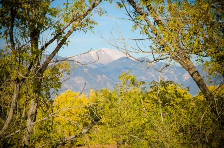 Pikes Peak framed by fall colors of Fountain Creek Nature Center, Funtain, Colorado