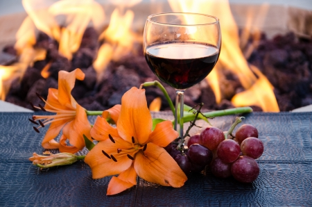 cabernet sauvignon: Grapes, lilly and Cabernet Sauvignon with fire pit