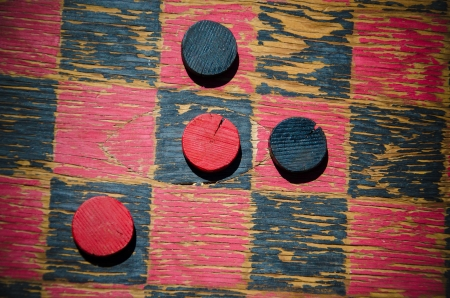 A homemade wooden checkers and checkerboard make nice composition