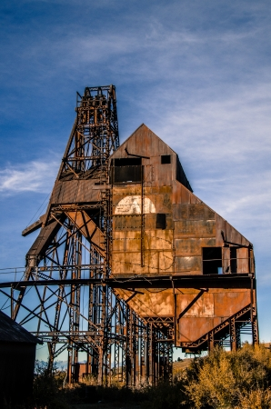 Early morning light illuminates the historic Theresea Mine in Victor, Colorado