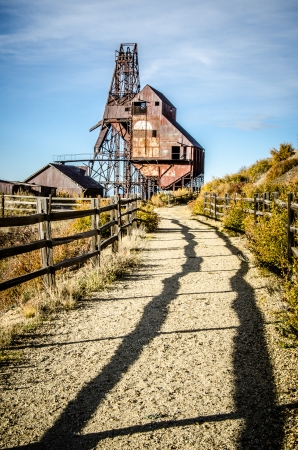 Pathway, fence and shadows lead to the hiistoric Theresea Mine, Victor, Colorado Reklamní fotografie