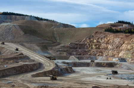 The active Cripple Creek and Victor Gold Mining Company cuts away layers of the landscape