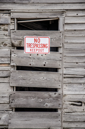 trepassing: A no trepassing kepp out sign on window of the remains of last wooden building of ghost town, Eastonville, on Colorado plains Stock Photo