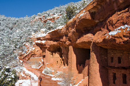 The amazing architecture of the Manitou Cliff Dwellings and fresh snow on a peaceful. sunny February morning.