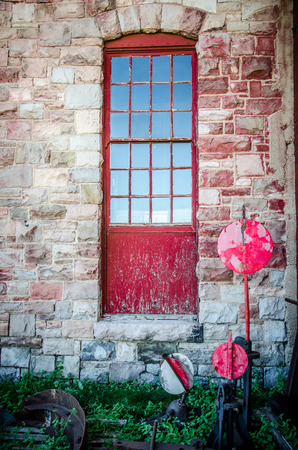 Red window and stone wall with vintage railroad signs at the Pikes Peak Trolley Museum in Colorado Springs, Colorado  photo
