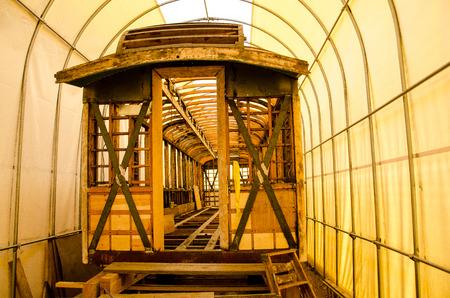 restored: Image of of vintage wooden trolley being restored at the Pikes Peak Trolley Museum in Colorado Springs, Colorado.