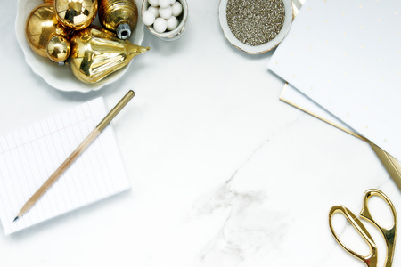 Elegantly styled Christmas desktop in white and gold. Copy space. Reklamní fotografie