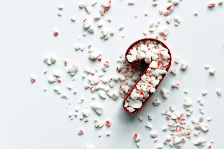 Crushed peppermint inside red candy cane cookie cutter. Reklamní fotografie