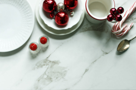 Christmas styled table setting with red and white decor.