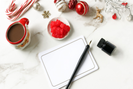 Christmas styled desktop with decorations, sweets and stationary. Copy space. Reklamní fotografie
