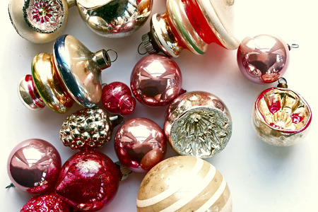 Vintage pink and pastel colored vintage ornaments above view. Stock Photo