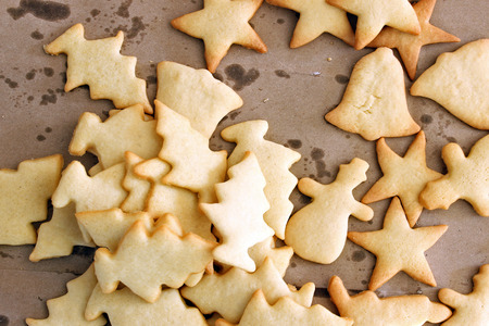 Plain sugar cookie cut outs in a pile. Copy space.