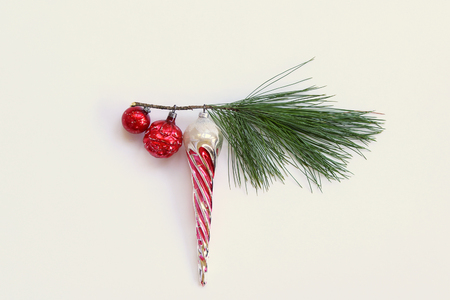 Minimalism concept of tree trimming with vintage ornaments on one evergreen branch