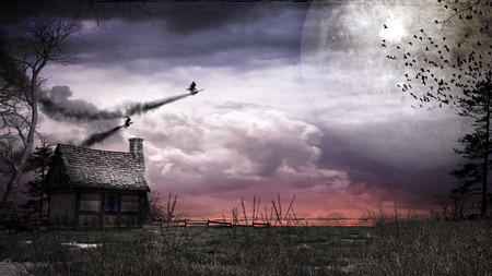 Night over small hut with huge moon and flying witches Фото со стока