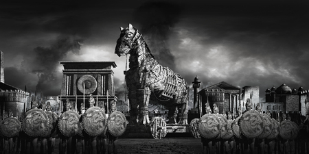 War scene with ancient city, warriors and wooden horse Фото со стока