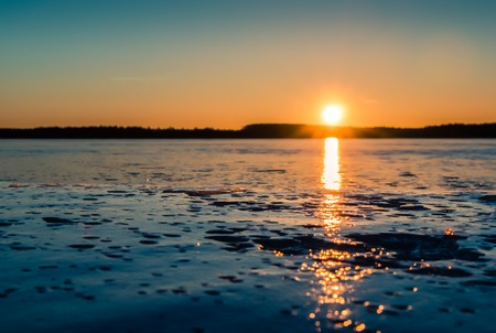gleaming: Sunset behind the ice in springtime Stock Photo