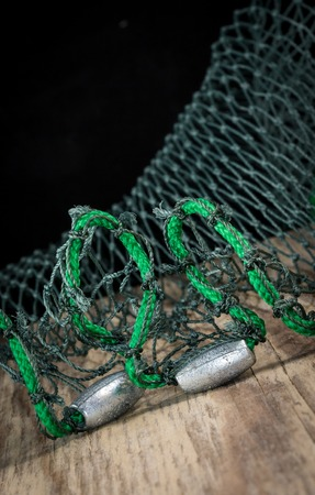 sinkers: Sinkers attached to the bottom of a fishnet