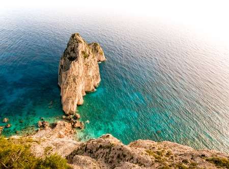 steep cliff: Turquoise sea and a steep cliff
