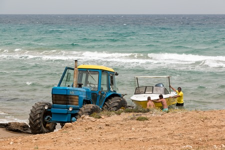 boat trailer: Tractor with a boat trailer towing a boat at Banana beach, Zakynthos, Greece Editorial