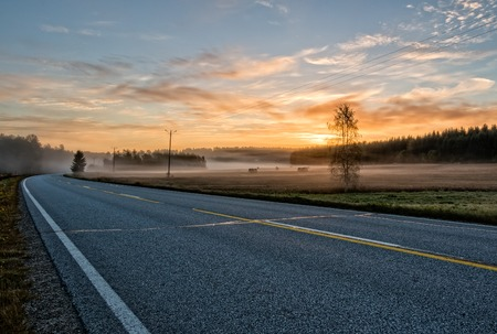 asphalt road in country landscape Stock Photo