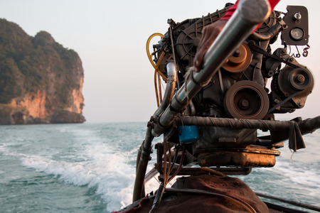 ascetic: Close-up photo of a running motor in a long-tail boat in Thailand.