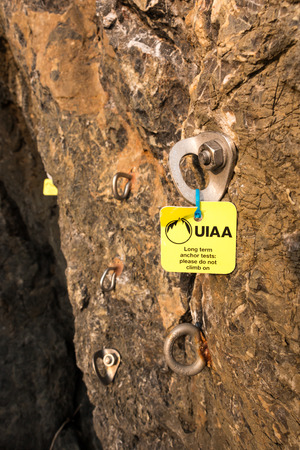 durability: AO NANG, KRABI, THAILAND - JANUARY 25:  Climbing anchors are attached to vertical rock surface for long term anchor tests of UIAA  (International Climbing and Mountaineering Federation) on January 25, 2014 in Ao Nang, Krabi, Thailand Editorial