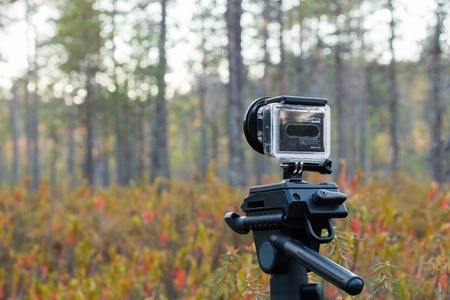 photography session: SAVONLINNA, FINLAND - SEPTEMBER:  GoPro branded action camera is attached on a photographing tripod for a timelapse photography session at a marsh on September, 2015 in Savonlinna, Finland