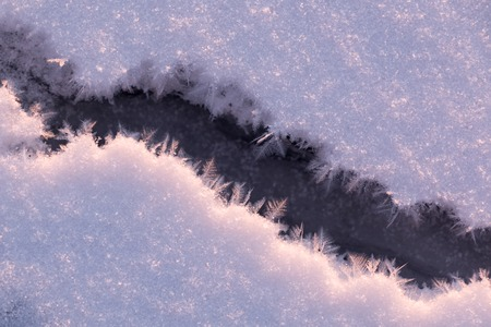 ice crystals: Frosty crack with beautiful ice crystals at a frozen lake in Finland.