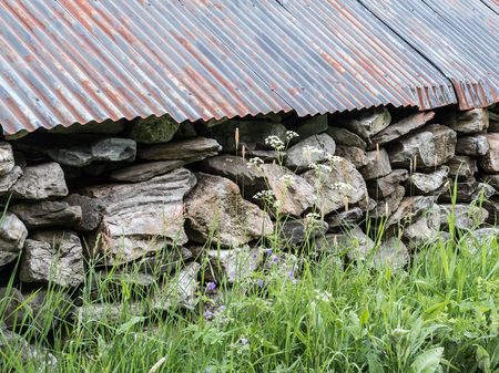 Old boathouse wall made of stones Stock Photo