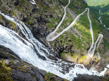Waterfall and serpentine road