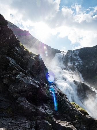Waterfall and lens flare Stock Photo