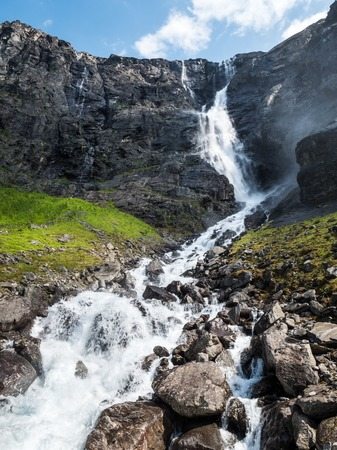 Waterfall and stream flowing on mountainside