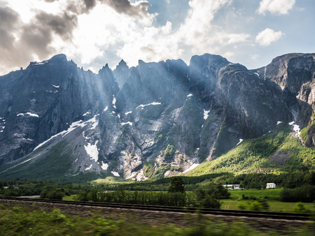 Railroad in country landscape with mountains