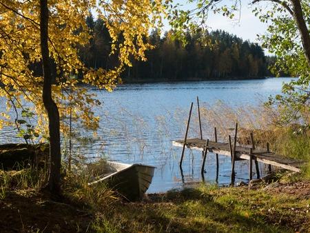 Beautiful lake shore with autumn colours
