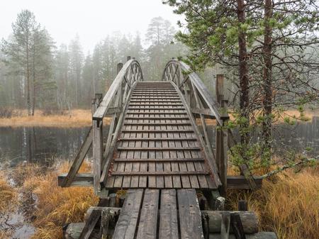 Wooden walking route bridge Stock Photo